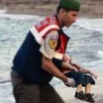 bambino polizia siriano
